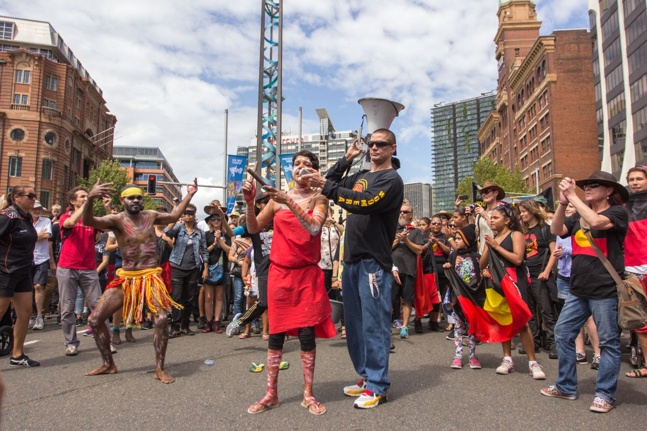 An Aboriginal traditional dance is performed in the middle of George Street intersection in Sydney's CBD, Australia. Every year on 26 January known as 'Invasion Day', Aboriginal people and supporters march to call an end to unequal treatment under government policies and for racist mistreatment by police forces.
