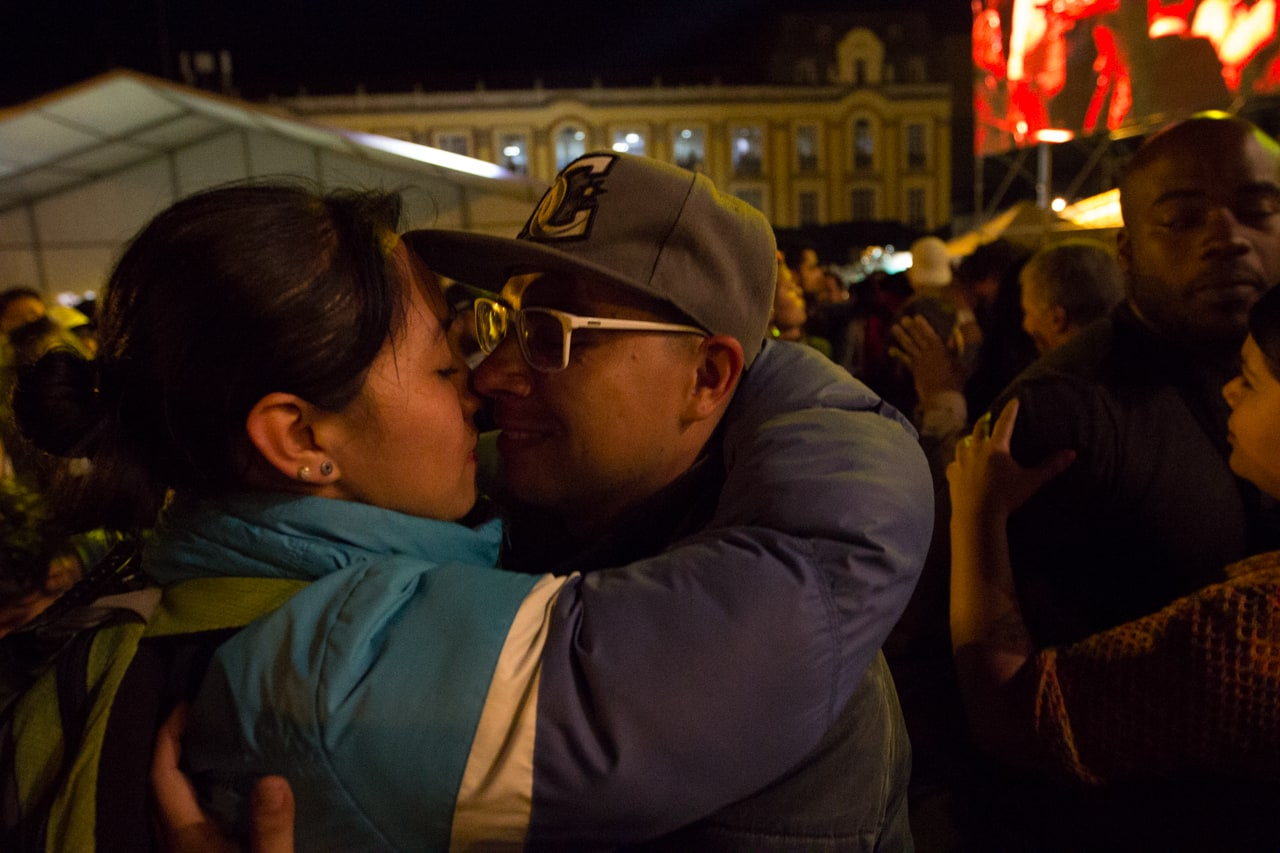 A couple embrace at the launch rally of the new FARC political party in Bogotá, Colombia.