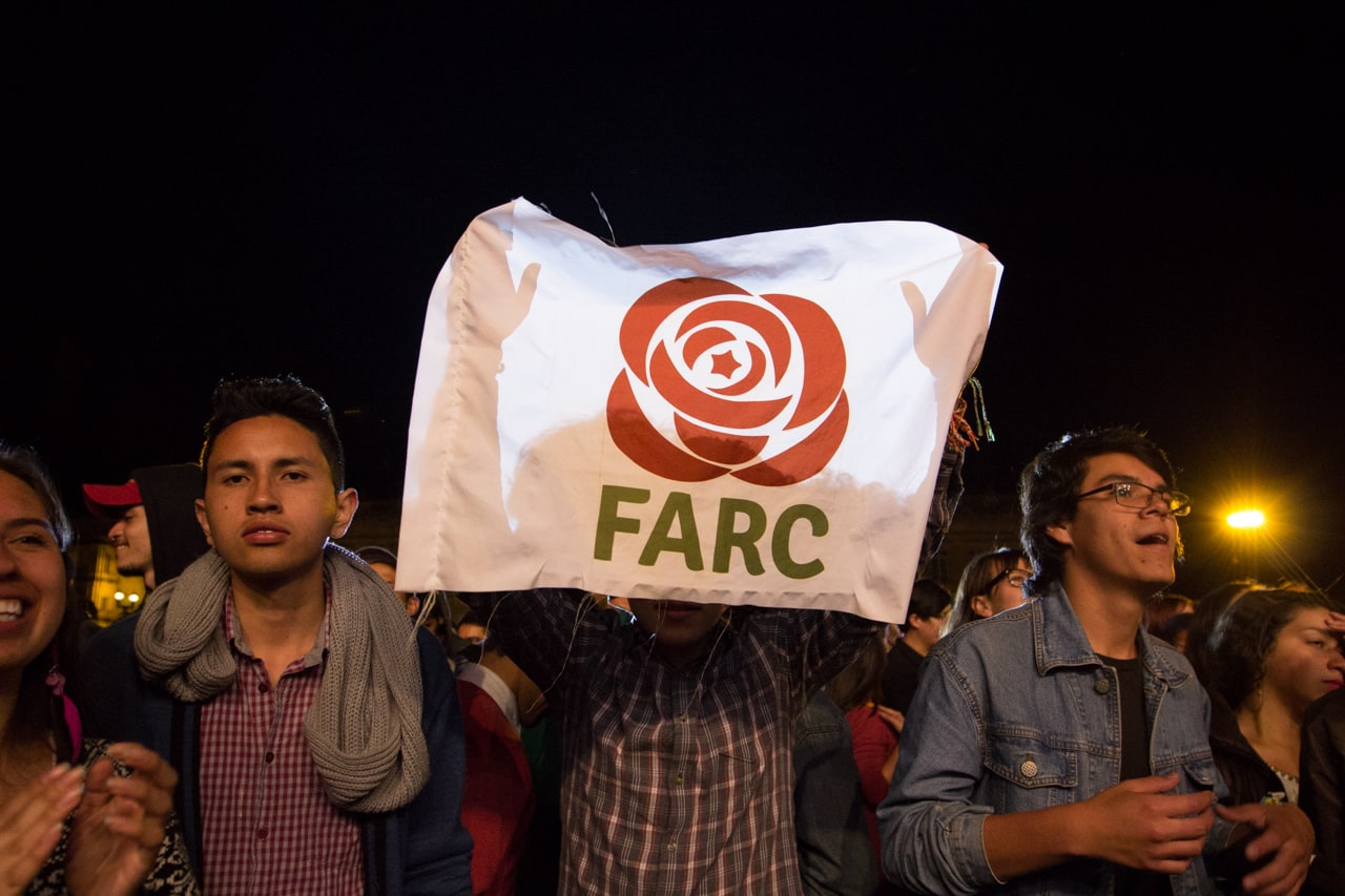 A supporter holds a sign for the FARC political part at their launch rally in Bogotá, Colombia.