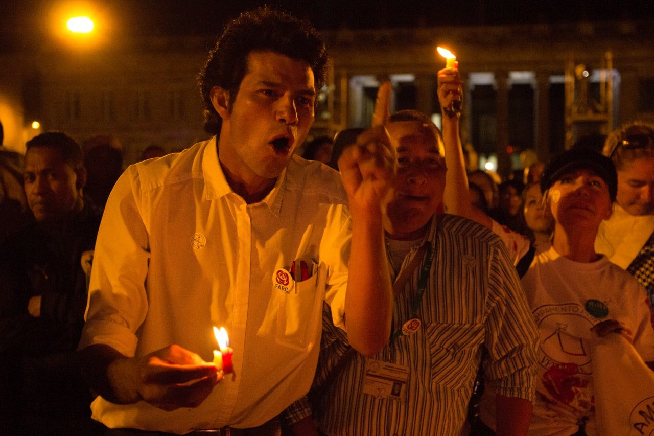 Supporters of the new political party FARC hold candles at a launch rally in Bogotá, Colombia.