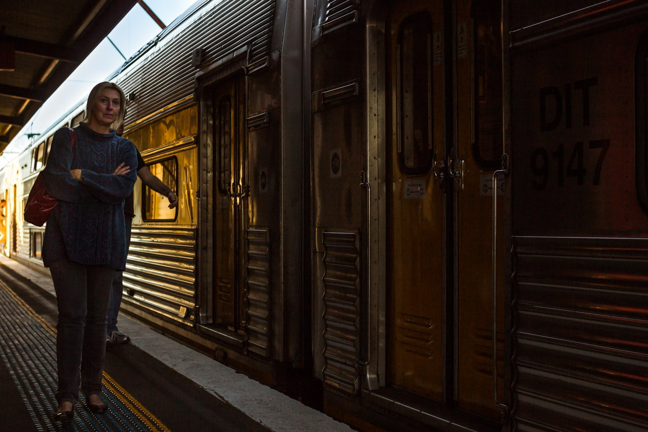 A woman waits to board a Blue Mountains line express service at 5 p.m at Blackheath Station.