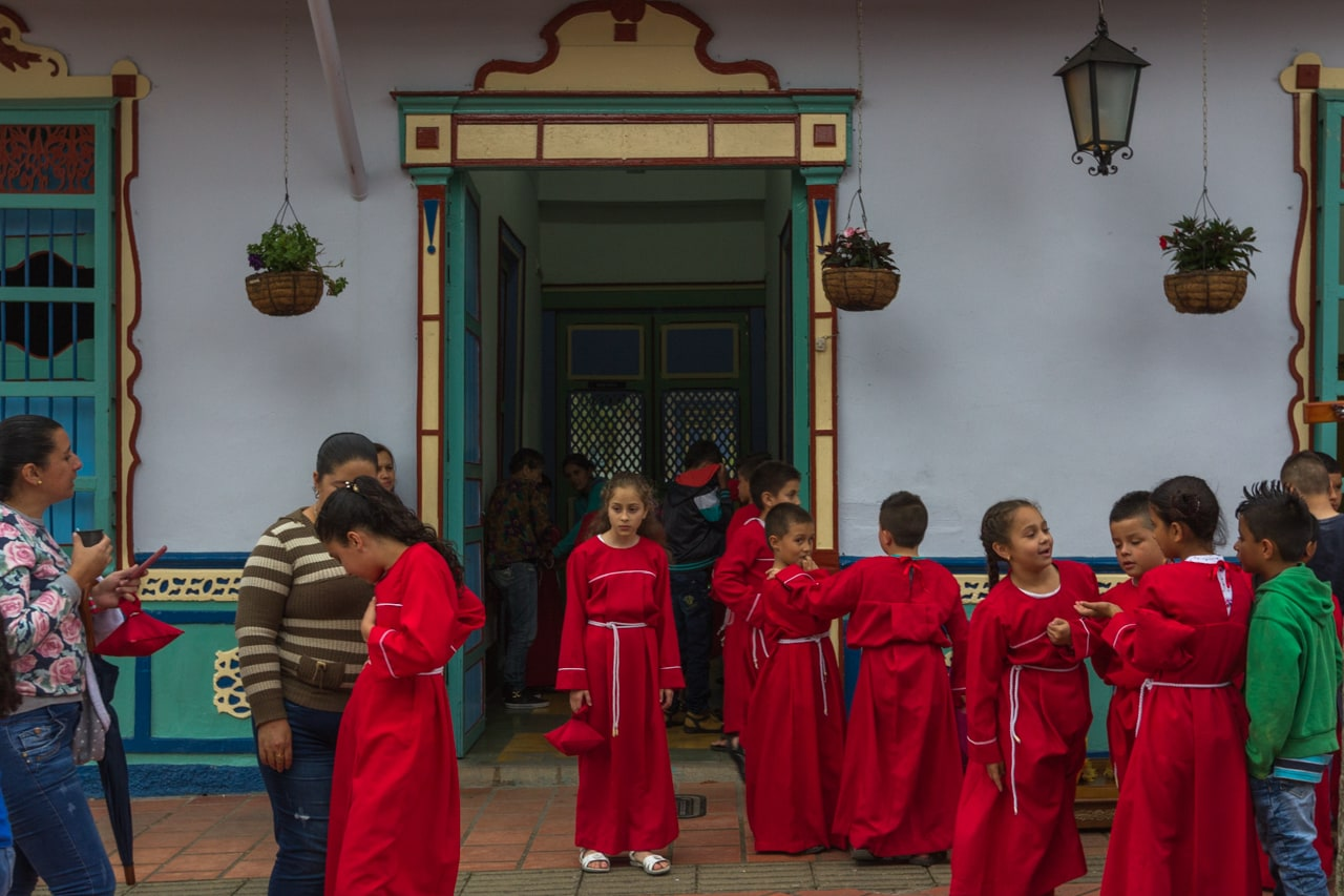School children in the town of Guatapé prepare for a ceremony.