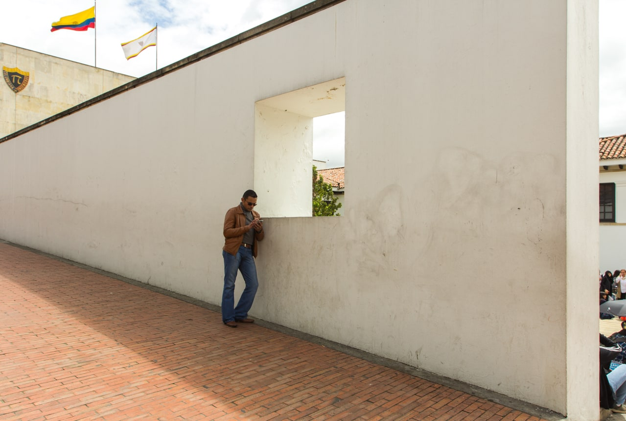 A man checks his phone outside the Museo del Banco de la República, in Bogotá's central district La Candelaria.