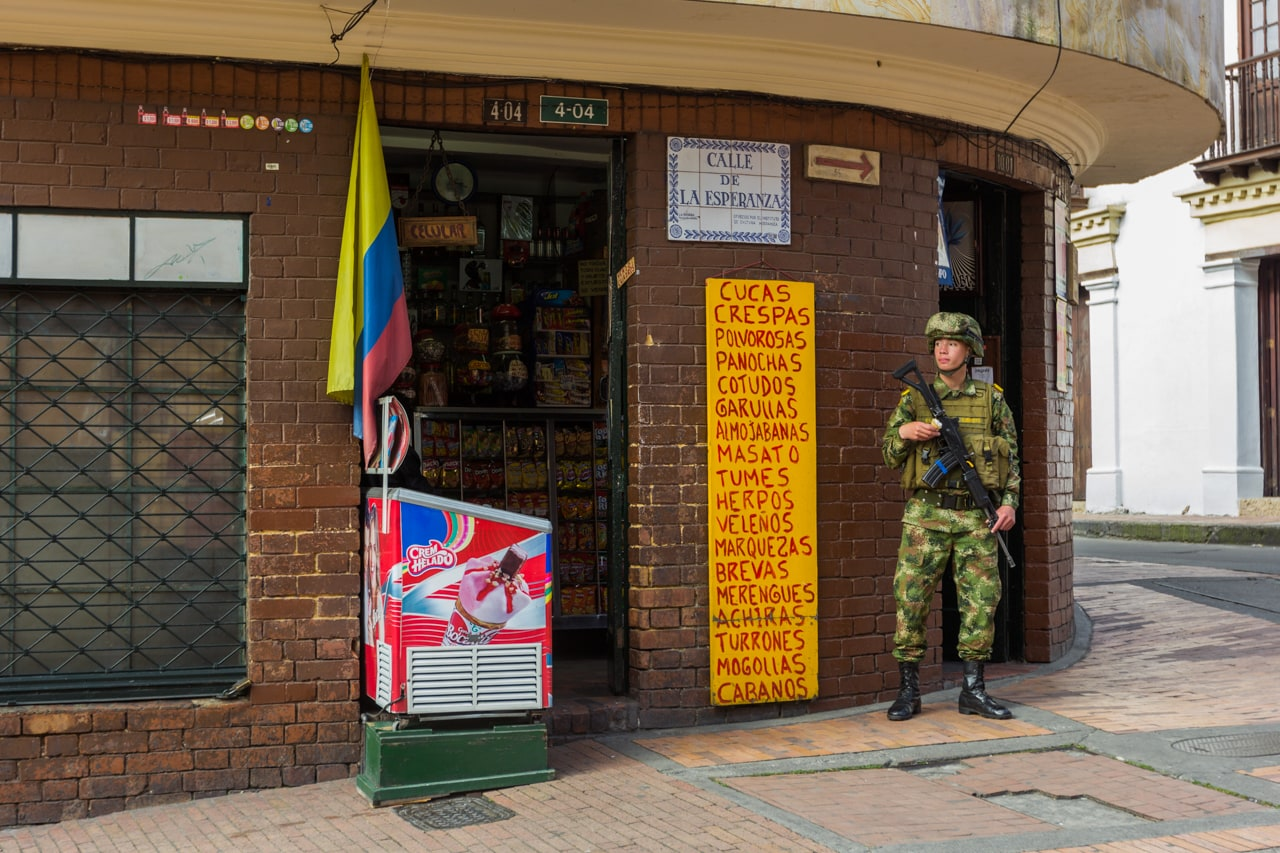 A soldier guards a street corner in Bogotá's central distict La Candelaria.