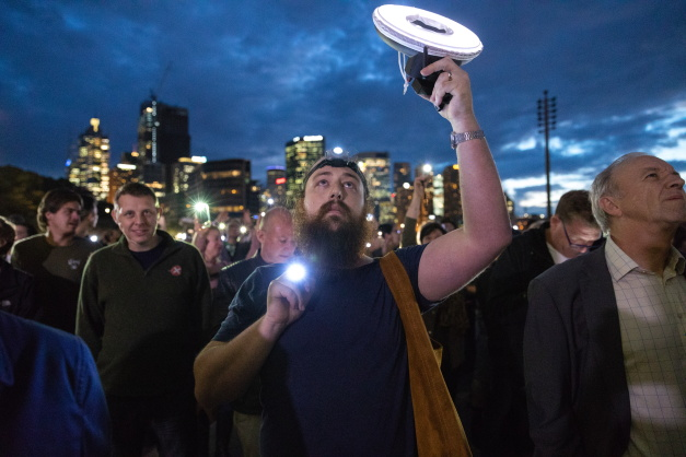 In photos: Torch protest disrupts a controversial Sydney Opera House gambling advertisement